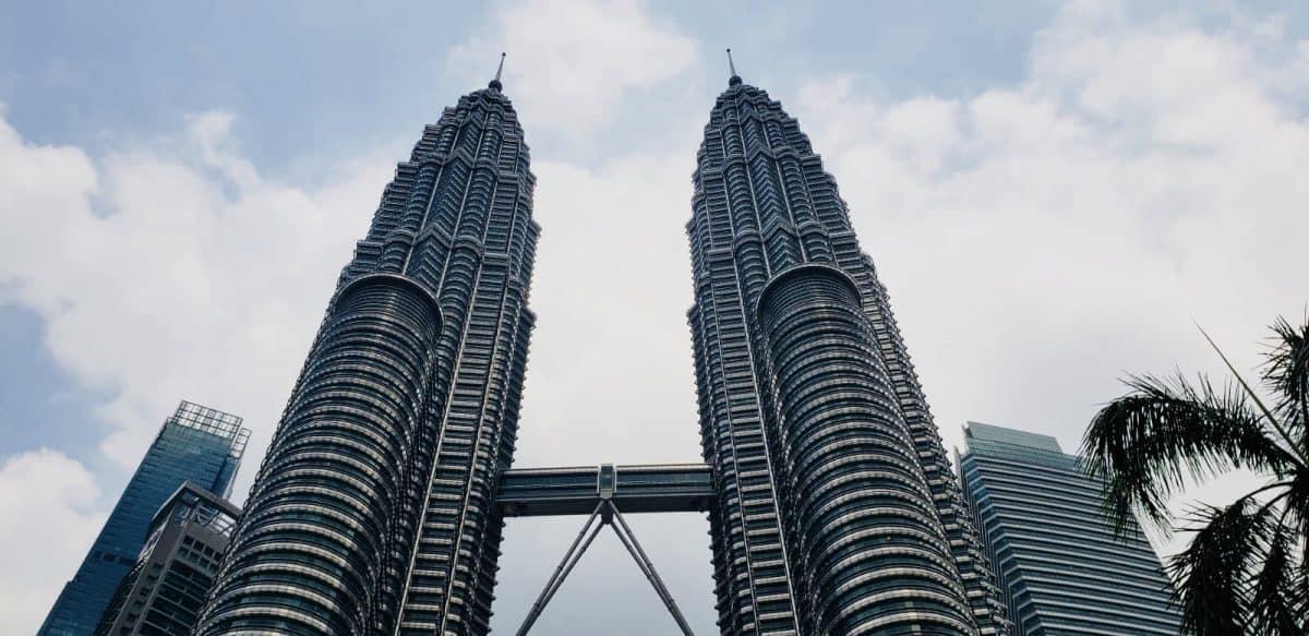 Looking up at the Petronas Twin Towers in Kuala Lumpur Malaysia